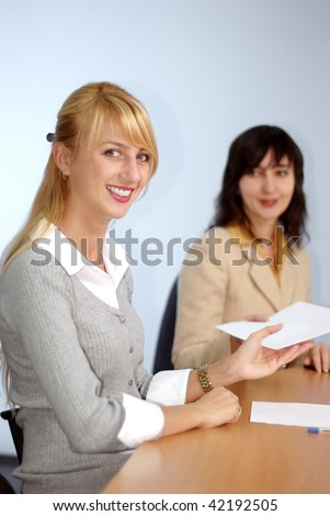 Blonde and brunette women on the meeting in the office
