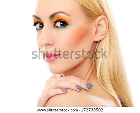 Blonde and really cute girl has colored makeup - stock photo