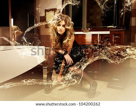 Blonde beautiful woman in bathroom with water