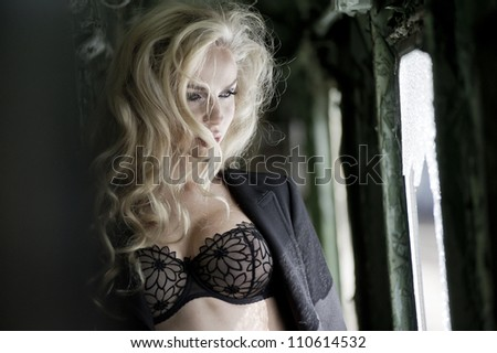 Blonde beauty posing in train - stock photo