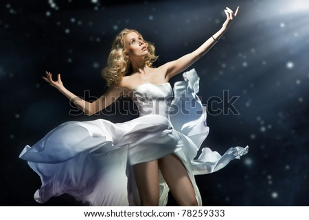 Blonde beauty posing over starry background - stock photo