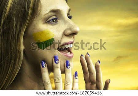 Blonde Brazilian fan celebrates - stock photo
