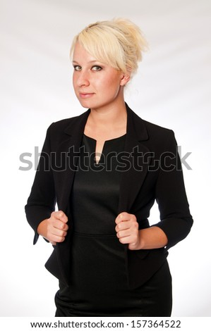 Blonde business woman in a black suit - stock photo