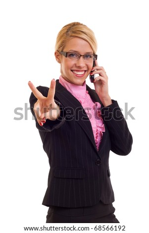 Blonde business woman with victory gesture and mobile phone