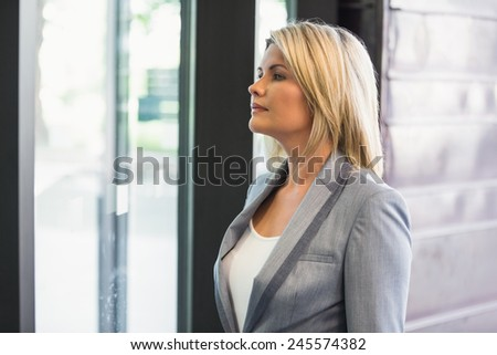 Blonde businesswoman waiting for someone in office building