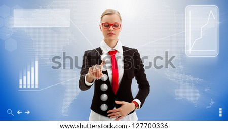blonde businesswoman works with the interface of the future, world map here it is - stock photo