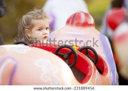 Blonde Child At Amusement Park Outdoor - stock photo