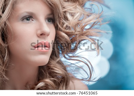 blonde curly woman dreaming - stock photo