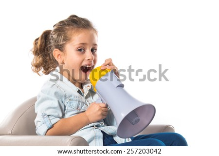 Blonde cute girl shouting by megaphone
