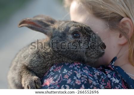 Blonde girl holding easter bunny - stock photo