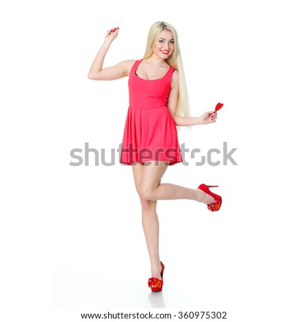 Blonde girl in a red dress with hearts on a white background