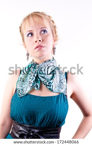blonde girl in green dress on white background