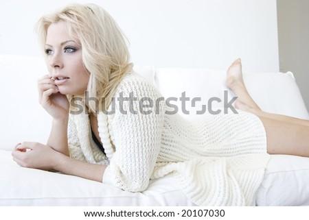 Blonde girl in white sweater - stock photo