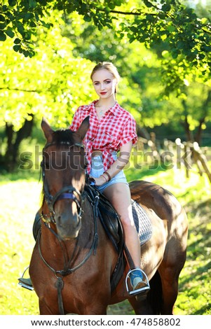 blonde girl on horseback