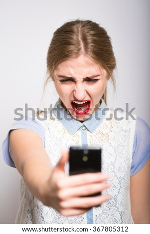 blonde girl screaming on the phone, isolated