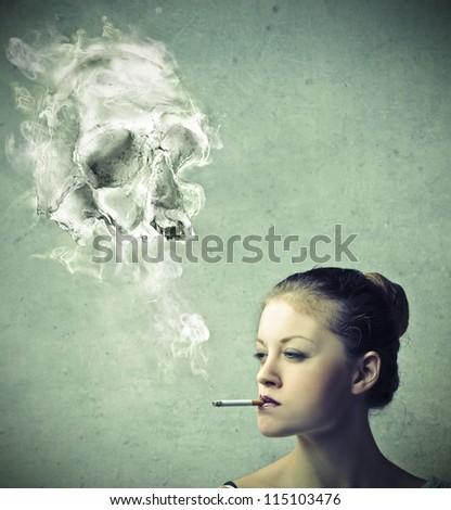 Blonde girl smoking - stock photo