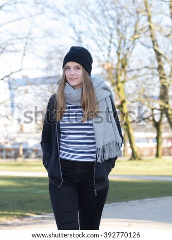 blonde girl walking in a park