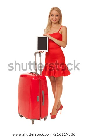 blonde girl wearing red dress holding tablet with big suitcase isolated on white background - stock photo