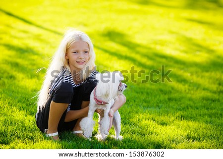blonde girl with a dog lapdog