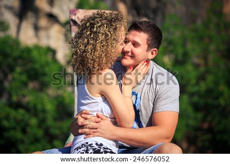 blonde girl with her boyfriend sit on longtail boat in Thailand - stock photo