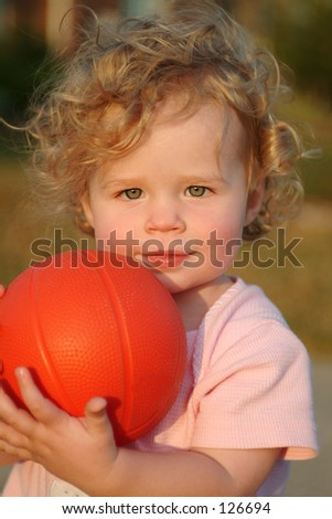 Blonde girl with orange ball