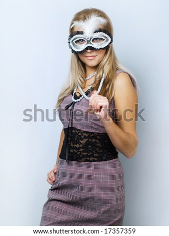 Blonde girl with silver mask on blue background - stock photo