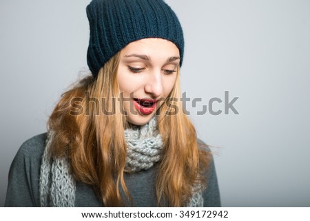 blonde girl with the book in hand, the concept of Christmas and New Year, studio photo isolated on a gray background