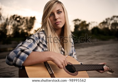 Blonde girl with the guitar - stock photo