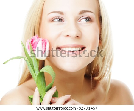 Blonde girl with tulip isolated on white