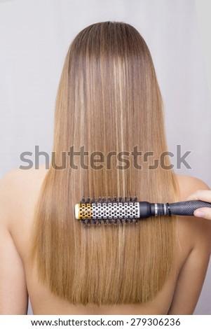 Blonde hair being brushed - stock photo