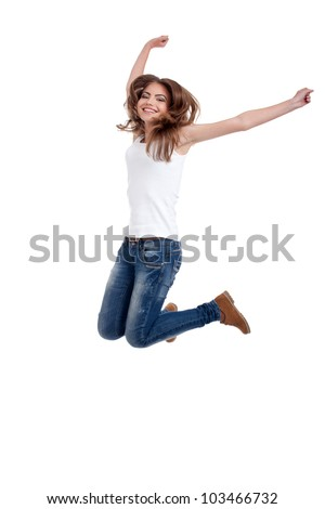 blonde, happy teen girl jumping, wearing jeans and white shirt, isolated on white background - stock photo
