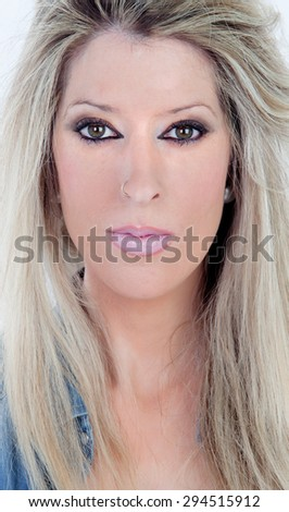 Blonde heavily made-up woman isolated on a white background