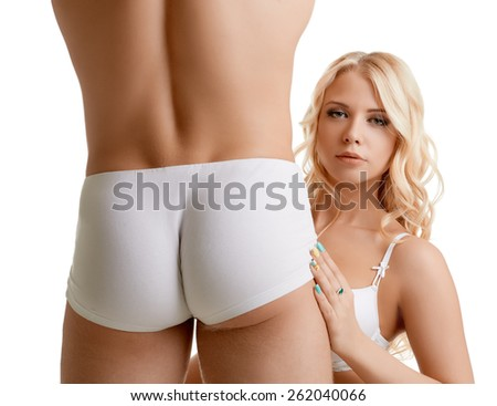 Blonde hugging muscular guy for ass, close-up - stock photo
