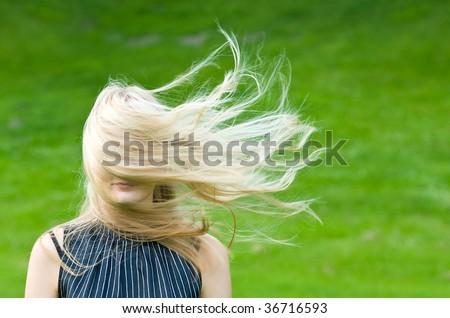 Blonde in a wind - stock photo