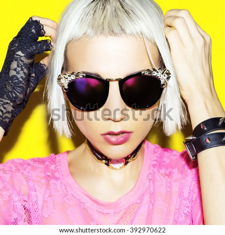 Blonde in Stylish Accessories. Sunglasses, Gloves, Bracelets