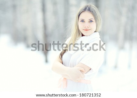 blonde in white dress snow high key - stock photo