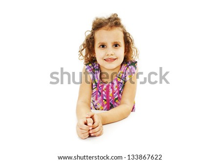 Blonde kid little student girl portrait smiling on a desk.  Isolated on white background