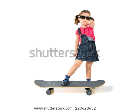 Blonde kid with skate over white background - stock photo