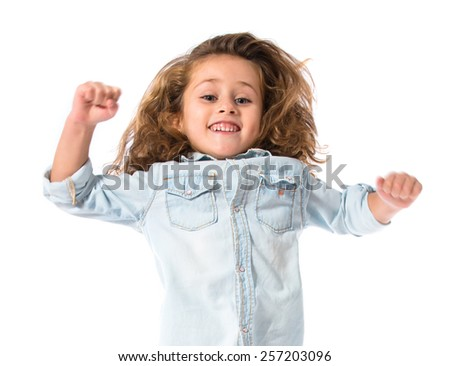 Blonde little girl jumping over white background - stock photo