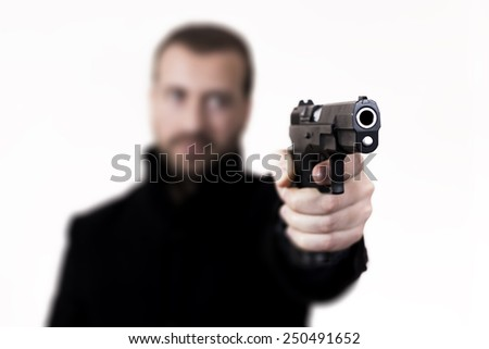 Blonde man with facial hair, aiming with a gun.