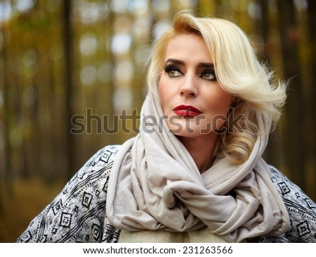 Blonde mature caucasian woman outdoor in the forest