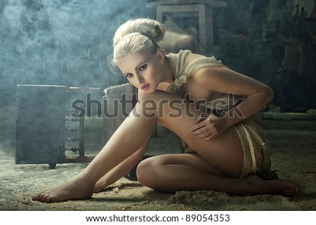Blonde model  in a vintage interior - stock photo