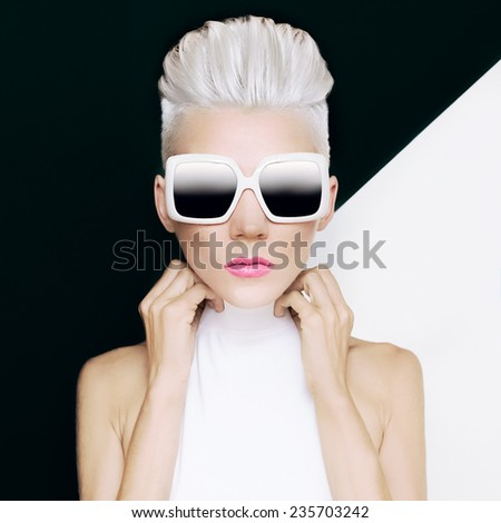 Blonde model in trendy sunglasses with stylish Haircut. Fashion photo - stock photo