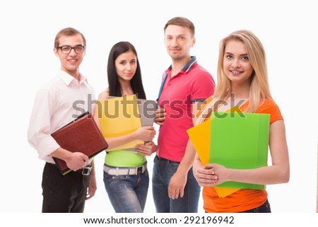 Blonde posing with green and orange document cases. Student in orange T-shirt smiling isolated on her collegues.
