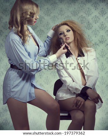 Blonde sexy girls posing in fashion creative portrait with cute hair-style, make-up and open shirt. Applying blush  - stock photo