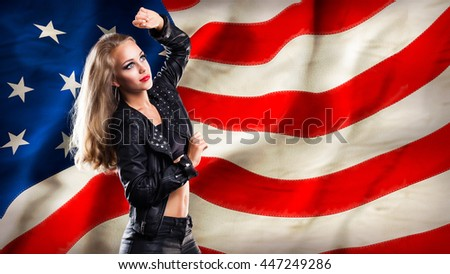 blonde smiling girl standing in front of a usa flag - stock photo
