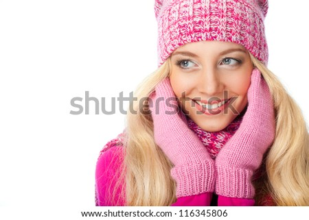 blonde smiling woman wearing pink knitwear over white background - stock photo