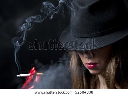 Blonde smoking cigarette young fashion girl - stock photo