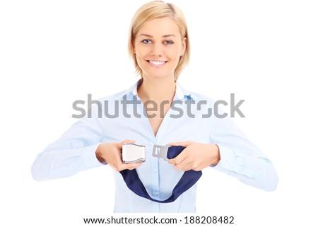 Blonde stewardess in blue shirt showing belt over white - stock photo