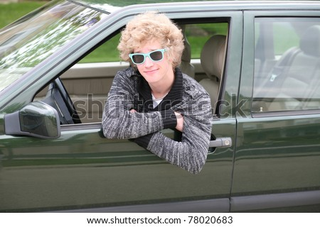 blonde teen boy with crazy hair and blue sunglasses